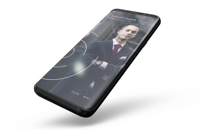 Mobile phone with an image of an executive on the home screen.